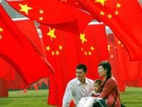 picture of chinese family under chinese flags
